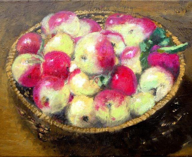 Bodegón de manzanas en una cesta