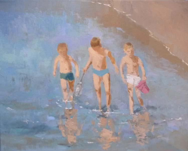 Niños buscando peces en la playa