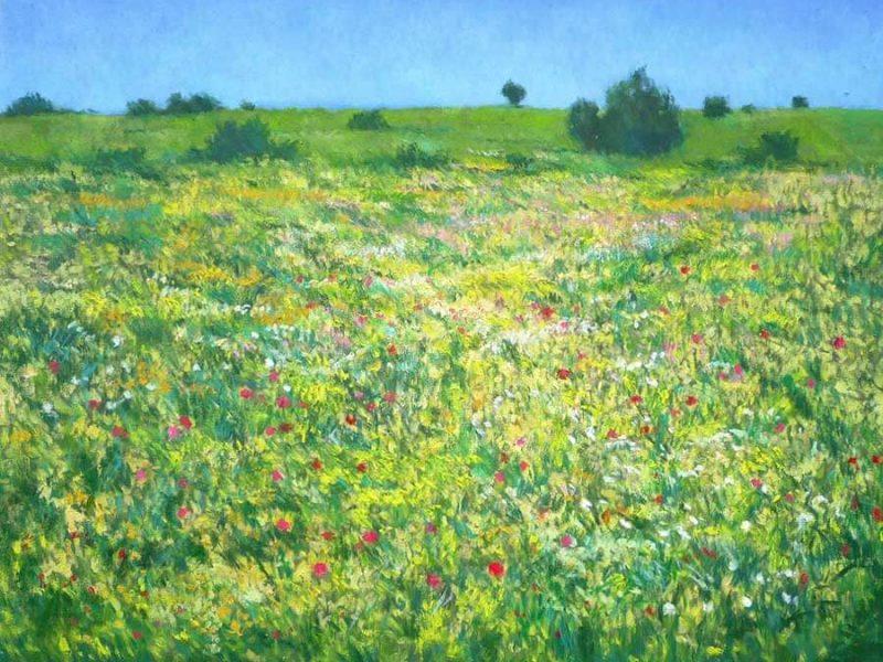 Cuadro de un paisaje de flores agitado por el viento