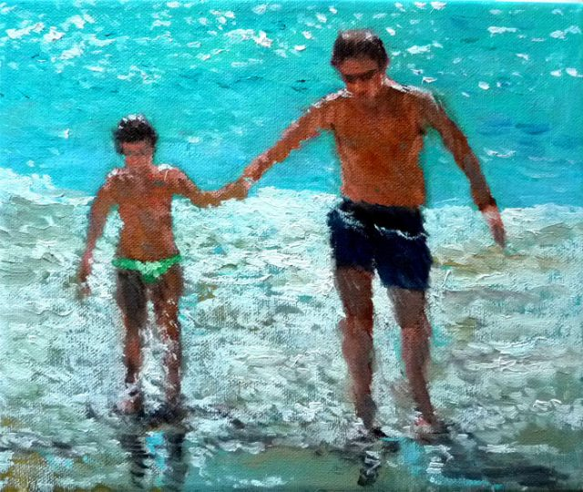 Niña con su padre en la playa