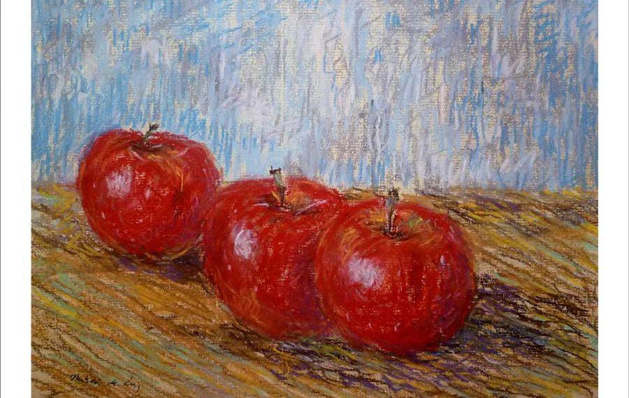 Bodegón pintado a pastel de unas manzanas en una mesa
